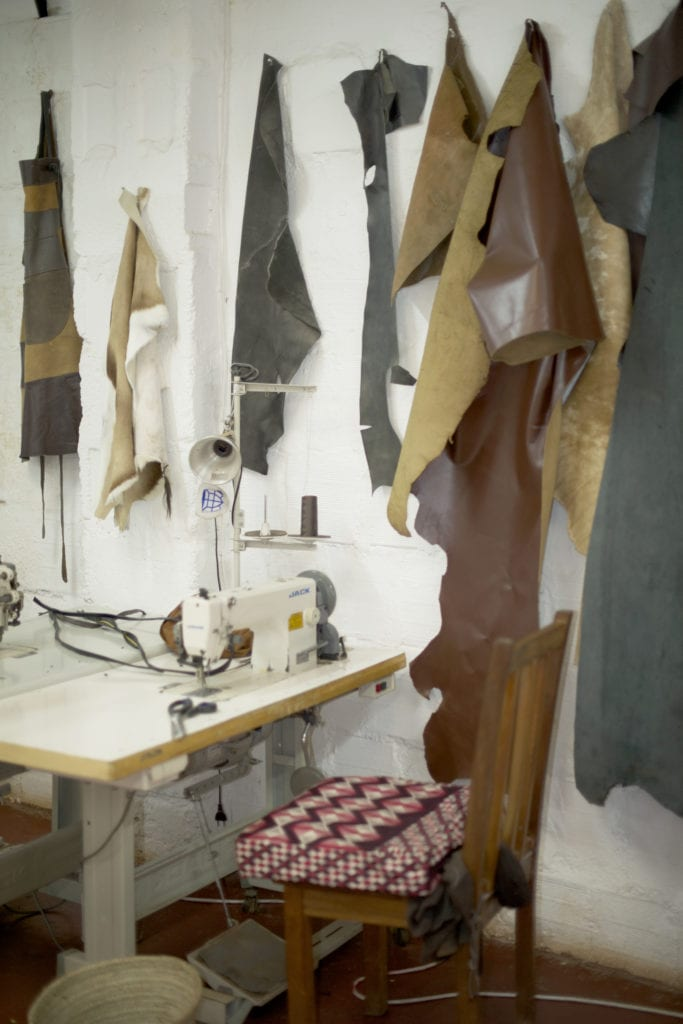 Leather pieces hanging in our workshop
