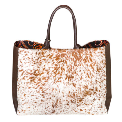 Adele Dejak brown and white cow hide and leather hand cut African inspired statement Stefania Hide bag with african print lining and mini clutch bag