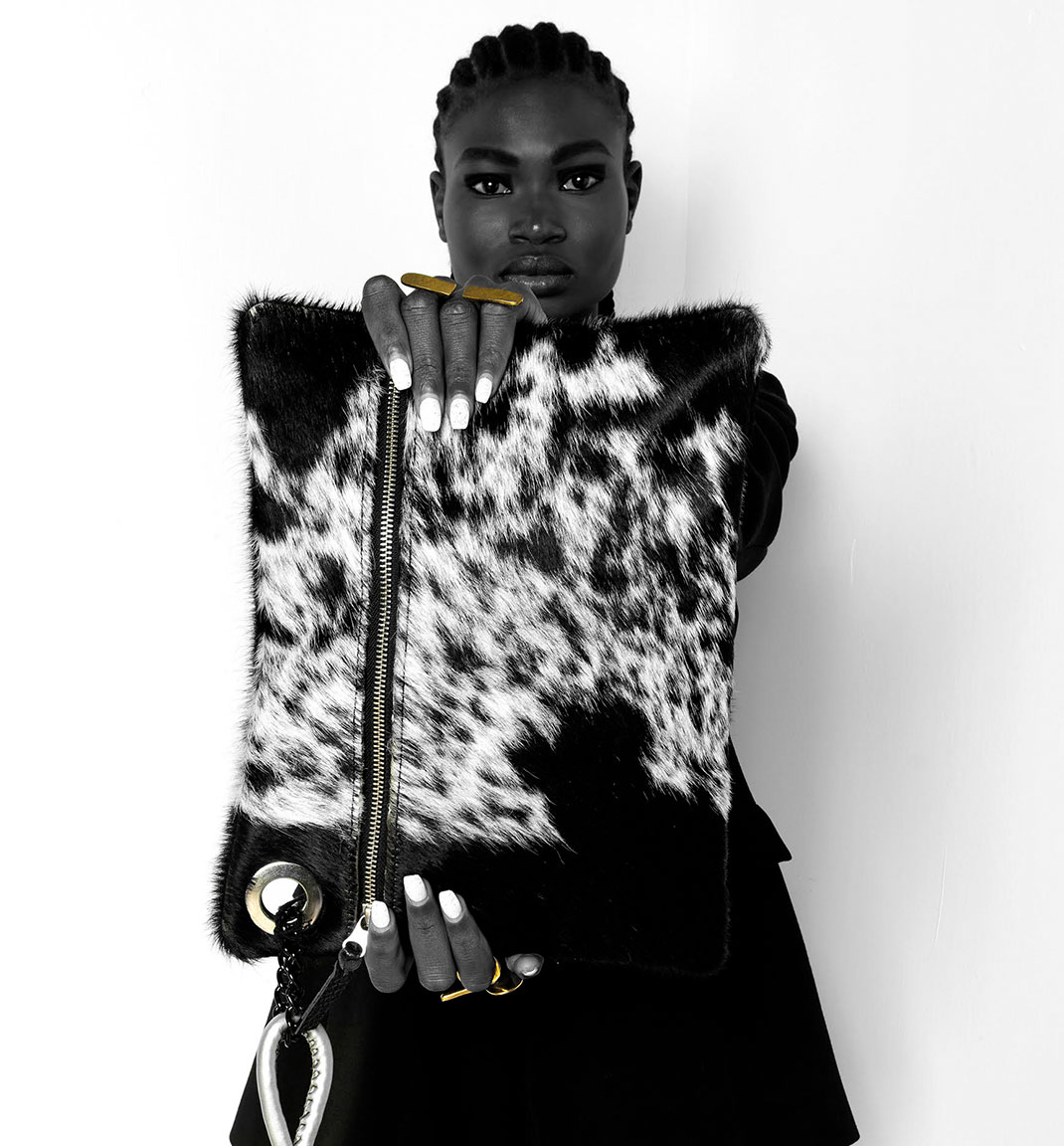 Adele Dejak African inspired cow-hide clutch-bag and recycled brass asymmetrical statement rings