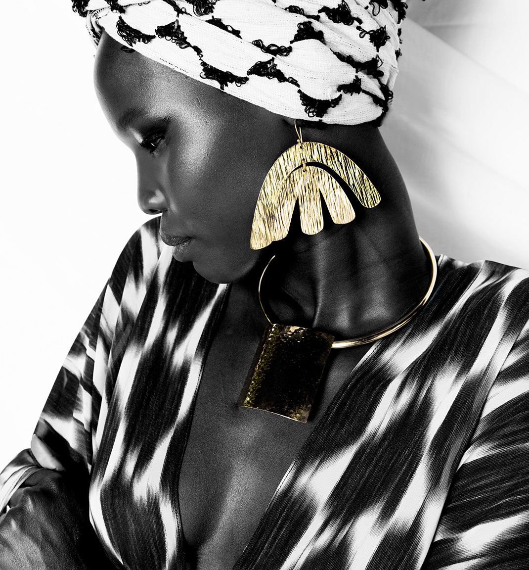 Adele Dejak brass gold-tone handmade African inspired bold statement double layered earring and simple neckpiece.